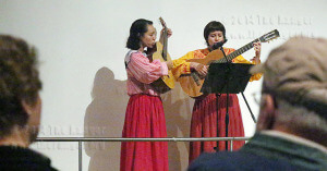 """Musical duo Los Inocentes performs """"corridos,"""" or ballads Sunday for a one-day event, Stories of Texas Migrant Workers, which featured two former migrant workers speaking at the Institute of Texan Cultures. The duo opened and closed the event with songs about hard work in the fields.  Photo by Milena Arias"""