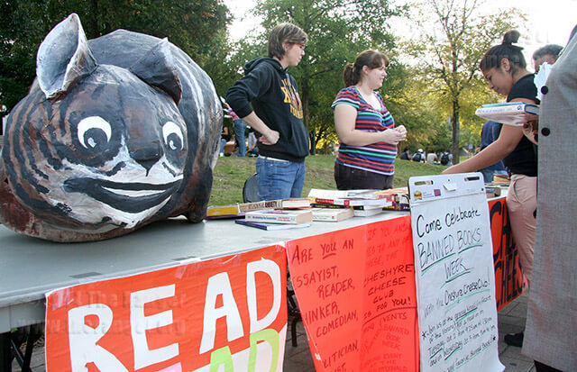 "Education sophomore Caroline Richardson and English sophomore Sarah Cowan of the Cheshyre Cheese Club peddled free books as part of banned books week and the ""Club Extravaganza"" on Oct. 3, 2007 in the mall area. Visit the ACLU Texas website at bannedbooks.info for more information.  File"