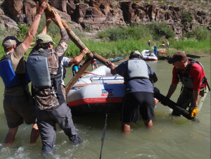 Participants in last year's Rio Grande clean up project work to remove an irrigation pipe.  Courtesy