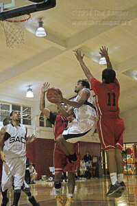 Fire science freshman Ajax Reyes maneuvers a layup around UIW guard R.J. Estrada and UIW forward Pete Perez on a drive to the basket Wednesday in the Wellness Center at UIW. Reyes scored on the play. The Rangers lost to the Cardinals 104-98.  Photo by R.T. Gonzalez
