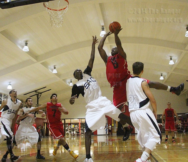 Rich Hardy, UIW guard, brushes past business sophomore Deron Taylor and kinesiology sophomore Cody Hastings on a drive to the basket Wednesday in the Wellness Center at UIW. Hardy made a 3-point play off Taylor's foul. The Rangers lost to the Cardinals 104-98. Photo by R.T. Gonzalez