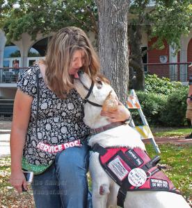 Chance gives English freshman Lacey Haugse a kiss.  Milena Arias