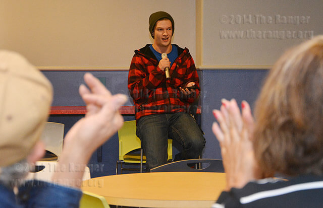 Education freshman Alex Kreider, reads one of his untitled poem to the audience, Thursday in the Loftin student center. The Chester Cheese Club hosted the last coffee night of the semester.