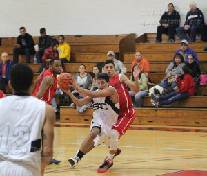 Fire science freshman Ajax Reyes drives past kinesiology freshman Marcus Perez in the first half of Wednesday's game against the Cardinals in Gym 1 of Candler. The Rangers won 80-77. Perez scored 16 points. Photo by E. David Guel