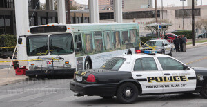 San Antonio Police Department vehicles block traffic on Main between Poplar and Cypress after a fatal shooting on VIA bus 90 around 2:45 p.m. Tuesday.  Photo by E. David Guel