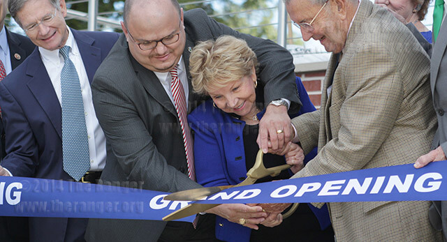 Officials cut a ribbon at the grand opening of Scobee Education Center Friday. From left are U.S. Rep. Lamar Smith; Dr. Robert Vela, president of this college; Dr. June Scobee Rodgers, Challenger Center founding chair; and Charles E. Cheever Jr., who with his son co-chaired the Challenger Learning Center capital campaign.  Photo by E. David Guel