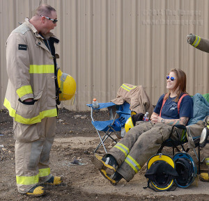 First Responders Academy student Sierra Hudson shares a laugh with classmate Kevin Shelhamer during a break Oct. 31 at Texas Auto Salvage.  Photo by Neven Jones
