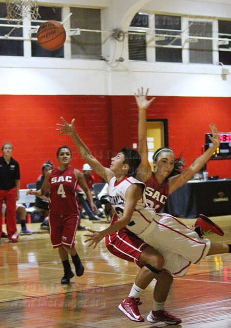 Kelley Moreno, UIW kinesiology freshman, makes an attempt to slide past communications sophomore Shannon Villenueva to score a basket Wednesday in the Wellness Center at UIW. The Lady Rangers lost to the Lady Cardinals 48-32.  Photo by R.T. Gonzalez
