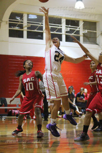Aimee Wood, UIW forward, lays up the ball to score against this college's Lady Rangers Wednesday at UIW. Architecture freshman Alexa Mallen fails at an attempt to block her. The UIW Lady Cardinals beat the Lady Rangers 48-32.  Photo by R.T. Gonzalez