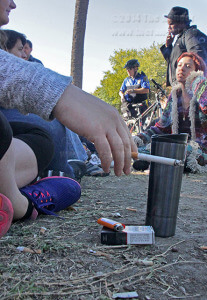 Students socialize during a smoke break between classes Oct. 15 at Dewey and Belknap.  Photo by E. David Guel