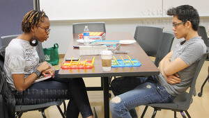 "Interpreting freshman Tanisha Morgan and deaf support specialist sophomore Trieu Le play ""Guess Who?"" at ASL Game Night Friday in Rooms 120 A and B of Nail.  Photo by Maria Duran"