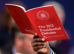 A debate booklet is held up after the second presidential debate between President Barack Obama and Republican presidential nominee Mitt Romney at Hofstra University.  AccuNet/AP