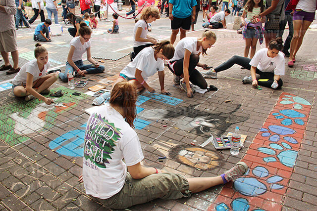 Students from Saint Mary's Hall upper class collaborate by painting their own ideas for a mural on Oct. 13 at Chalk It Up along Houston Street downtown.  Photo by Gloria Fernandez De Clements