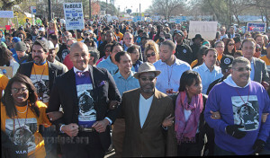 District 2 councilman Alan Warrick Jr., Rodney Taylor and wife Mayor Ivy Taylor, and commission chair David Copeland lead the Martin Luther King Jr. March Jan. 19 from the Martin Luther King Jr. Academy to Pittman-Sullivan Park. More than 175,000 marched the 2.75 miles.  Photo by E. David Guel