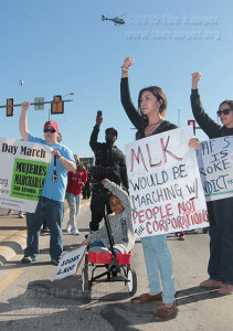 Angelina Valdez, 4, and her aunt Yvonne Valdez, former student at this college and Northwest Vista, hold fists up in memory of Michael Brown and Marquise Jones during the Martin Luther King Jr. March Jan. 19 along Martin Luther King Drive west of Highway 90. Brown was shot by Ferguson, Mo., police officer Darren Wilson Aug. 9, and Jones was shot by San Antonio police officer Robert Encina Feb. 28.  Photo by E. David Guel