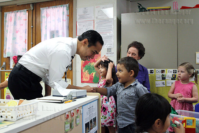 Mayor Julian Castro shakes hands with Ethan Gutierrez Sept. 21 at the early childhood center. Castro visited the center to promote Pre-K 4 SA, an initiative to increase pre-kindergarten locally. If voters approve the 1/8th of a cent tax increase Nov. 6, it would bring in $30 million for the program. It would cost $7.81 annually per median household.  Photo by Vincent Reyna