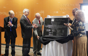 """President Robert Zeigler; Chancellor Bruce Leslie; David Mrizek, vice president of college services; Robert Vela, vice president of student and academic success; and District 7 trustee Yvonne Katz unveil the new plaque that will hang in Moody Learning Center during the rededication ceremony Oct. 10. See """"Moody is rededicated after renovation"""" online.  Photo by Emily Rodriguez"""