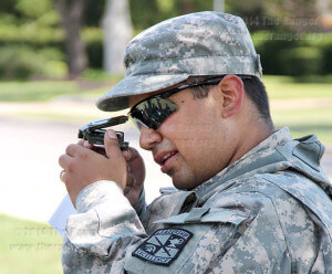 ROTC Cpl. Frank Carreon, psychology sophomore, practices using a compass at the compass familiarization station of a land navigation drill in San Pedro Springs Park.  Photo by Nicole West