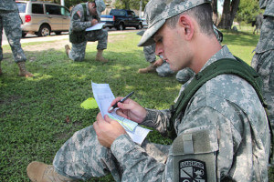 ROTC Pvt. Nick Rehberg, business freshman, practices using a scale map at the orienteering techniques station.  Photo by Nicole West