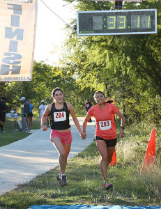 Haleigh Hunter-Galvan, left, O'Connor High School student and mom Liza Hunter-Galvan are first 5-mile runners to cross the finish line.  Photo by Robbin Cresswell
