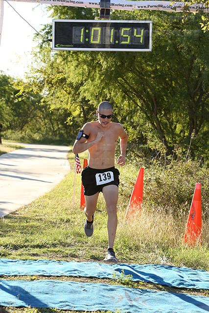 Kinesiology sophomore Elijah Martinez is the first 10-mile runner to cross the finish line Saturday during the SAC Boot Camp.  Photo by Robbin Cresswell