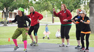 Zumba instructor Dalia Torres leads participants in the energy zone. Torres also instructs at Gold's Gym No. 895 in Live Oak.  Photo by Jovan Ibarra