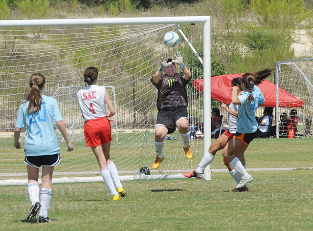 criminal justice sophomore Andrea Villarreal, goalie, jumps up to block a shot.  Photo by Gloria Fernandez De Clements