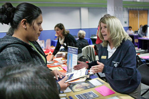 Liberal arts sophomore Angela Polendo talks to Cheryl Hollenshead, associate director of transfer admissions at St. Mary's University.  Photo by Monica Correa