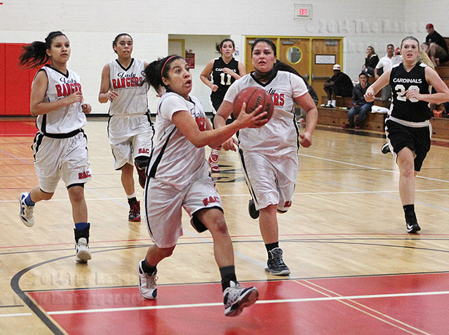 Graphic design sophomore Bea Garcia charges down the paint as she attempts a layup during the first half of the Lady Rangers' 51-28 win over University of the Incarnate Word Lady Cardinals Wednesday in Gym 1 of Candler.  Photo by Daniel Arguelles