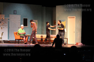 """The cast of """"The Boys Next Door"""" rehearses a scene as theater Professor Charles Falcon directs Monday in McAllister.  Photo by Daniel Arguelles"""