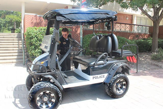 Chief Police Don Adams provides a tour in the new electric carts distributed to Alamo Colleges district police.  Photo by Jennifer Coronado