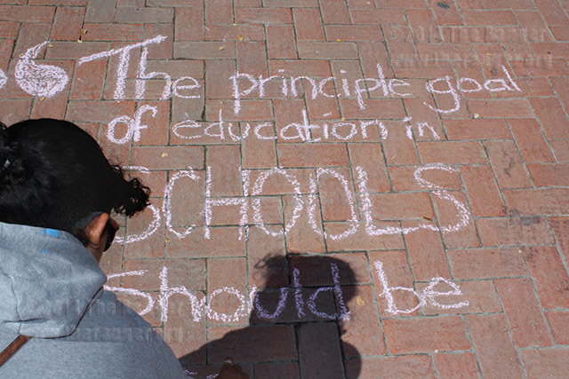 Math freshman Sarah Rodriguez expresses her opinion during Chalk Day Oct. 8, 2010, south of Loftin. Schools should teach students more individualism instead of conforming to how society believes students should be taught, Rodriguez said.  File