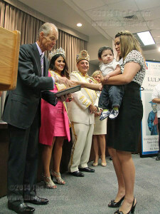 President Robert Zeigler hands management science freshman Frances Cortez and her son Raphael Moreno the LULAC Parent/Child Scholarship Award Sept.9 in visual arts.  Photo by Gloria Fernandez De Clements