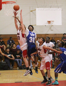 Engineering sophomore David Wright reaches for a rebound against liberal arts freshman Marcellus Garrick during the first half of Wednesday's game.  Photo by E. David Guel