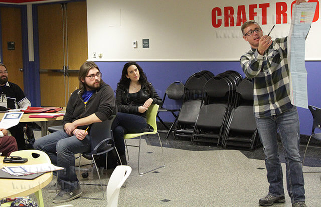 """Hunter Hodge, vice president of leadership for Phi Theta Kappa, shares the 2015 five-star chapter plan with the honor society at the Beta Nu chapter meeting Monday in the craft room. Hodge and his colleagues aspire to """"expand our presence in the community.""""  Photo by Tress-Marie Landa"""