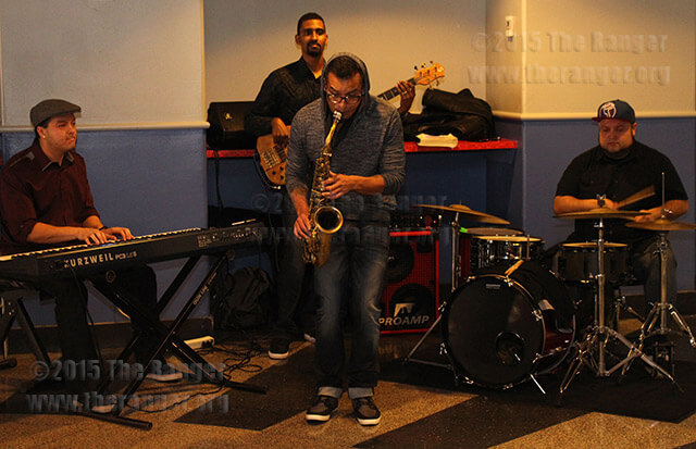 The band Alpha Soul performs Tuesday during the Fat Tuesday celebration in Loftin. Band members include keyboardist Chris Villanueva, bassist Sean Byrd, saxophonist Valentino Maltos, and drummer Armando Aussenac.  Photo by Jack Jackson