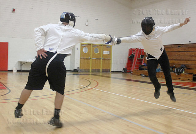 Kinesiology junior Felix Castillo learns how to disengage from criminal justice sophomore Christopher Perez in sabre fencing Tuesday in Gym 1. In sabre fencing the target is from the waist up, including the head.  Photo by Vanessa Frausto