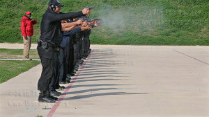 Chief tactical Instructor M.C. Joseph supervises cadets from this college's Law Enforcement Training Academy shooting at the First Responder's Academy in Von Ormy. The 22 cadets shot targets in the shape of human silhouettes from the 15-yard line. They also shot targets at 3 yards, 5 yards, 7 yards and 25 yards.  Photo by Daniel Carde