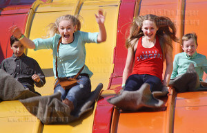 Hannah Hagan, 14, screams with excitement and stepsister Courtney Rhoden, 13, holds on while riding the Super Slide Saturday. Heather attends Dobie Junior High and Courtney attends Driscoll Middle School.  Photo by Pam Paz