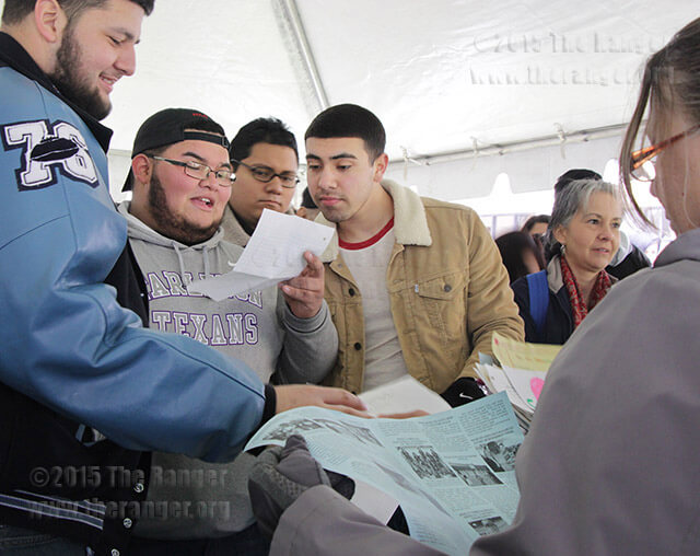 Robert Sifuentes, Joshua Martinez and Thomas Gonzalez, South San Antonio High School seniors, look at letters they put in a time capsule as third graders in 2006.  Photo by Pam Paz