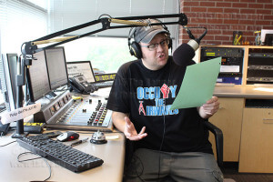 Charlie Castleman reads different pledges during the annual KSYM pledge drive April 2013.  File