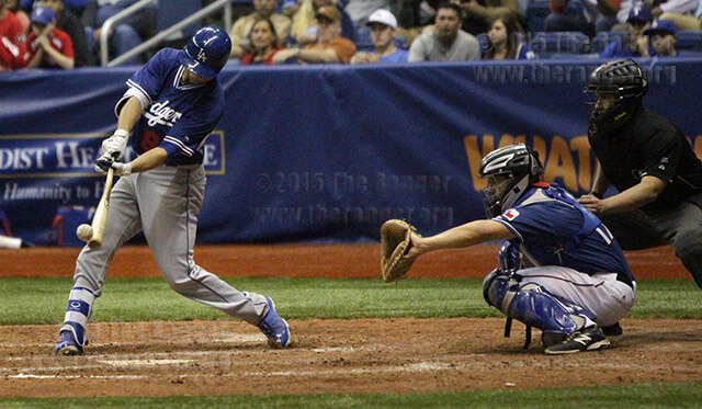 Buck Britton, Los Angeles Dodgers infielder, swings and hits in the top of the ninth inning of an exhibition game against the Texas Rangers as part of the H-E-B Big League Weekend March 21 in the Alamodome. The Dodgers defeated the Rangers 11-3.  Photo by E. David Guel