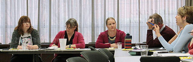 "Amy Whitworth, chair of the language, philosophy and culture department, addresses the Faculty Senate March 4 in the visual arts center. The Senate proposed topics such as Covey training for the upcoming Academic Success Committee meeting. Faculty Senate also discussed the $31,300 spent on new ID badges with ""value statements,"" the library budget and 4DX.  Photo by Anthony B. Botello"