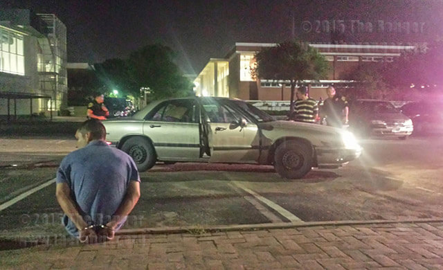 Two suspects were arrested Wednesday night in Lot 21 of this campus after a hit-and-run accident on the corner of San Pedro and West Park. The driver, who is standing by the car, did not have a license and was arrested for an outstanding DWI warrant. No one was hurt during the accident.  Photo by Cynthia M. Herrera