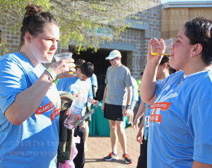 Kawisse Davidson and  Martha Galindo, kinesiology sophomore at this college, hydrate after running the 5k. Galindo learned about the run from physical conditioning adjunct Chris Dillon and Davidson accompanied her girlfriend for a new experience.  Photo by Vanessa Frausto