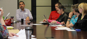 Richard Farias, director of student activities, discusses budget issues during the student services fee advisery committee meeting April 2 in Fletcher. Farias informed participants of possible budget shortfalls in the near future.  Photo by Jack Jackson