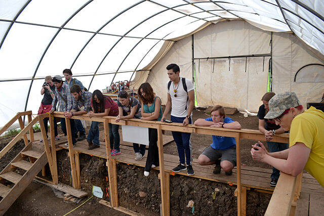 Students in anthropology Adjunct Wesley Copas' archaeology class observe the Gault excavation site March 28. This is the third consecutive semester he has taken his students to visit the site and the Gault School of Archaeological Research at Texas State University.  Courtesy