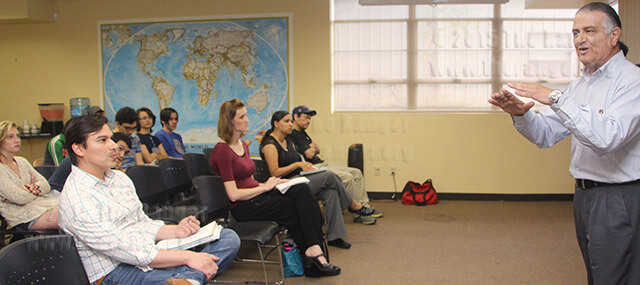 """Asslan Khaligh, government and political science professor, expresses his views on the delusion of Muslim youth at the Hot Potato discussion March 31 in the Methodist Student Center. Khaligh spoke on recent news of Muslim youth joining ISIS, saying they """"are suppressed and impressionable, looking for something to stand for,"""" but emphasized the need to """"educate on a productive, non-violent alternative to radicalism.""""  Photo by Tress-Marie Landa."""