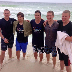Communication arts sophomore Andrew 'Fin' Esteves, second from left, enjoys the surf with new friends in Panama City Beach, Fla., during a ministry trip over spring break. He was the only Alamo Colleges student who went, and one of four students from the San Antonio area to spend their spring break evangelizing on the beach.  Courtesy