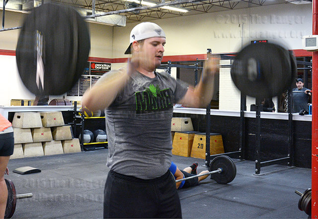 Communications sophomore Ryan Truss works out at 5 a.m. April 6 at Mission CrossFit. Truss said the CrossFit community inspires him to stay in shape.  Photo by Neven Jones
